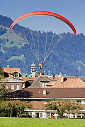 01 AUGUST 2007 -- INTERLAKEN, BERN, SWITZERLAND: Parasailers land in the park in Interlaken, Switzerland. Interlaken, in the canton of Bern, is the heart of the Bernese Oberland and the center of the region's tourism industry.  Photo by Jack Kurtz