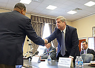 Agriculture Secretary Tom Vilsack shakes hands with Representative Sanford Bishop, Jr. (D-GA) before the start of a hearing with the House Appropriations Agriculture subcommittee on the USDA's fiscal 2014 budget proposal in the Rayburn House Office Building in Washington, DC on Tuesday, April 16, 2013.