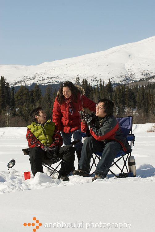 Men and woman ice fishing in the Yukon<br /> <br /> NOT IN YOUR BUDGET? Contact Cathie for a price specific to your project.