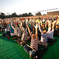 ART OF LIVING DEVOTEES PREPARTING FOR WORLD RECORD 4000 FLUTIST PLAYING FLUITE AT A TIME. FIRST OF ITS KING EVENT IN THE UNIVERSE. FLUTIST DOING BHASRIKA PRANYAMA BEFORE PRACTICING THE RAGA.