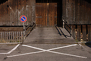 A Clearway sign banning vehicles from parking in front of a typical Alpine barn in Leonhard-St Leonardo, a Dolomites village in south Tyrol, Italy.