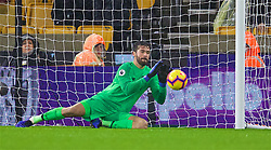 WOLVERHAMPTON, ENGLAND - Friday, December 21, 2018: Liverpool's goalkeeper Alisson Becker makes a save during the FA Premier League match between Wolverhampton Wanderers FC and Liverpool FC at Molineux Stadium. (Pic by David Rawcliffe/Propaganda)
