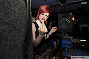 Mika, a teenage transvestite, giving the finger, The Junk Club, Southend, UK 2006