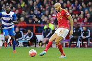 Nottingham Forest defender Kelvin Wilson makes a pass during The FA Cup third round match between Nottingham Forest and Queens Park Rangers at the City Ground, Nottingham, England on 9 January 2016. Photo by Aaron Lupton.