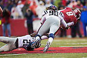 FAYETTEVILLE, AR - NOVEMBER 22:  Senquez Golson #21 and Fadol Brown #90 of the Ole Miss Rebels tackle Austin Allen #8 of the Arkansas Razorbacks at Razorback Stadium on November 22, 2014 in Fayetteville, Arkansas.  The Razorbacks defeated the Rebels 30-0.  (Photo by Wesley Hitt/Getty Images) *** Local Caption *** Senquez Golson' Fadol Brown; Austin Allen