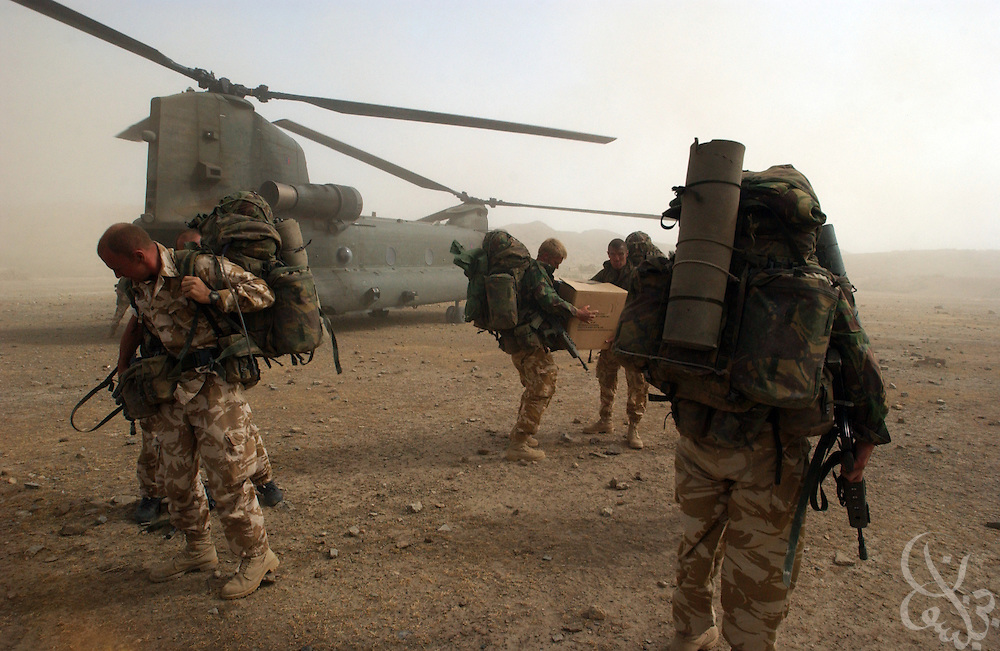 British Marine commandos leave a Royal Air Force Chinook helicopter during Operation Buzzard June 18, 2002 in southeastern Afghanistan. Britain is expected to begin withdrawing its 1,700 troops currently deployed in Afghanistan by the end of June 2002.