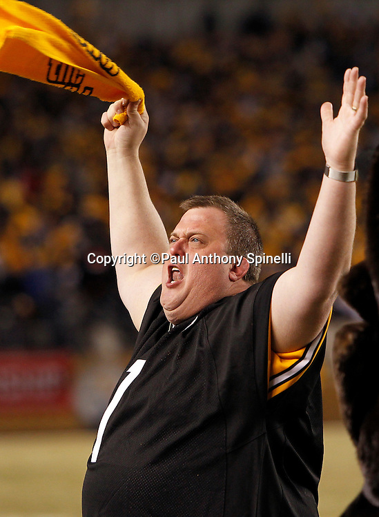 Actor Bill Gardell waves a terrible towel and fires up the fans prior to the Pittsburgh Steelers NFL 2011 AFC Championship playoff football game against the New York Jets on Sunday, January 23, 2011 in Pittsburgh, Pennsylvania. The Steelers won the game 24-19. (©Paul Anthony Spinelli)