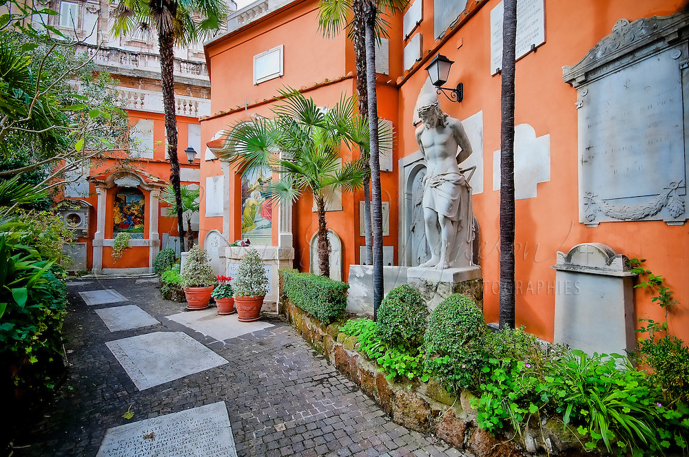VATICAN CITY, VATICAN - NOVEMBER, 20: Campo Santo Teutonico It is the oldest German National Foundation in Rome. Located left of the Basilica of St. Peter, the Teutonic cemetery surrounded by a wall, does not attract immediate attention, but the charm of this cloister full of history opens quickly in the same way more urgent. Here once stood the circus of Nero, which was the scene of the martyrdom of many Christians. After the sack of Rome, the Swiss chapel was the burial place of the guards.<br /> Because of its rather unique position, the cemetery is of course always been a very popular place of burial. According to the statutes, persons who are entitled to burial in this place are the members of the Confraternity, members of several religious houses of German origin and two other German colleges in Rome: the &quot;Anima&quot;and &quot;Germanico . It also contains the graves of famous dead in the areas of church life, art, politics or diplomacy.<br /> The last burial was that of the young Prince Alexis of Windisch-Graetz in 2010. It was the second son of Prince Hugo, one of the gentlemen of Pope Benedict XVI, and the Archduchess of Habsburg.