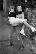 Nev carrying Fiona, High Wycombe, 1980s.