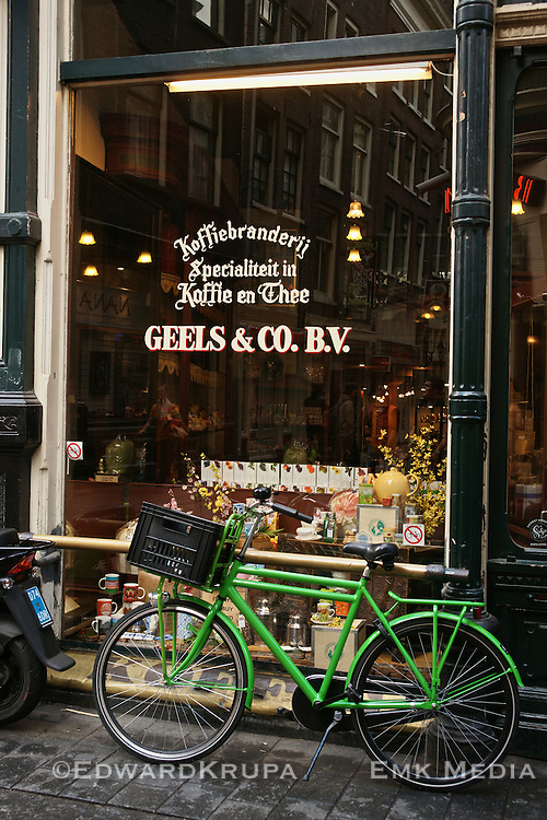 Green bike in front of cafe in Amsterdam.