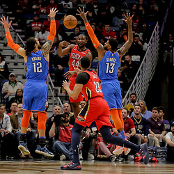 Dec 12, 2018; New Orleans, LA, USA; New Orleans Pelicans forward Solomon Hill (44) passes to forward Anthony Davis (23) as Oklahoma City Thunder center Steven Adams (12) and forward Paul George (13) defend during the first quarter at the Smoothie King Center. Mandatory Credit: Derick E. Hingle-USA TODAY Sports