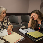 WASHINGTON,DC-AUG21: Sheila Thomas (left) and Kate Billingsley share research on their family genealogy at the Georgetown library, in Washington, DC, August 21, 2017. Sheila is presumed to be the great-great-great granddaughter of Roger B. Taney, the U.S. Supreme Court chief justice who said blacks had no rights and could not be U.S. citizens. Kate Billingsley is a descendant of Taney, her father is Charles Taney III, a distant nephew of Roger Brooke Taney.  Kate and Sheila would be distant cousins. (Photo by Evelyn Hockstein/For The Washington Post)