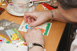 Person doing a craft activity at a resource for people with physical and sensory impairment.