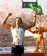 Adriano Bastos, left, of Brazil, celebrates with Goofy after winning the Walt Disney World Marathon in Lake Buena Vista, Florida.