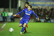 AFC Wimbledon midfielder Jake Reeves (8) battles for possession with Rochdale midfielder Nathaniel Mendez-Laing (11) during the EFL Sky Bet League 1 match between AFC Wimbledon and Rochdale at the Cherry Red Records Stadium, Kingston, England on 28 March 2017. Photo by Matthew Redman.