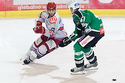 Marjan Manfreda (HK Acroni Jesenice, #18) vs Jeff Tory (HDD Tilia Olimpija, #47) during ice-hockey match between HDD Tilia Olimpija and HK Acroni Jesenice in 41st Round of EBEL league, on Januar 23, 2011 at Hala Tivoli, Ljubljana, Slovenia. (Photo By Matic Klansek Velej / Sportida.com)