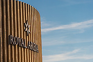 A split frame close-up of The Royal Arena with insignia set against a blue sky in Copenhagen.