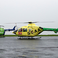 FREE TO USE PHOTOGRAPH....30.10.15<br /> Scotland's Charity Air Ambulance (SCAA) unveiled it's new helicopter at Perth airport this morning a EC135 T2i (pictured) which replaces the Bolkow 105 helicopter which is retiring from service. The new helicopter will increase speed, range, endurance and payload, allow SCAA to fly at night and in cloud. Picture shows the new EC135 T2i landinf next to the Bolkow 105  it os replacing<br /> for further info please contact Maureen Young on 07778 779000<br /> Picture by Graeme Hart.<br /> Copyright Perthshire Picture Agency<br /> Tel: 01738 623350  Mobile: 07990 594431