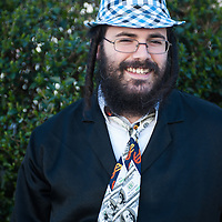 London, UK - 16 March 2014: a man  from the Orthodox Jewish community of Stamford Hill wearing a tie with dollars celebrate the festivity of Purim, dancing and singing in the streets at the sound of Yiddish music and visiting wealthy businessmen collecting for their charity