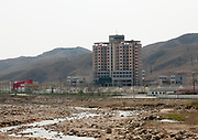 KUMGANG<br /> THE NORTH KOREAN GHOST TOWN<br /> <br /> The first town USA will find on his way to invade NK will be this ghost town where HUnday lost 1 billion USD..<br /> <br /> The Mount Kumgang tourist complex in North Korea, near the DMZ, was built in 1998 by the South Korean giant company Hyundai. The chaebol paid a fee of $1 billion to the North Korean government for 50 years of exclusivity. The cost of the 500-square kilometer complex was $400 million, including hotels, a spa, a fire station, a tourism office, a golf course, a supermarket, a clinic, tours in the mountain... Kumgang resort attracted nearly 2 millions south korean tourists from1998 to 2008.<br /> In July 2008 a South Korean tourist, Miss Park Wang-ja, was shot dead there and South Korea decided to stop all the tours in North Korea. The North Korean government said the tourist entered the military zone, and ignored the warnings from the north korean soldiers.<br /> So in retaliation, North Korea decided to seize the whole tourist complex. This decision was a real drama. Not for the touristic industry only, but for the separated families from the south and the north: Kumgang was also the place where hundreds of North and South Korean relatives were meeting each other for the first time in decades.<br /> For those reasons, since 2008, Mount Kumgang complex has became a ghost town. Only very few western tourists could visit the area.<br /> <br /> Photo shows:    Hyundai paid a fee of $1 billion to the North Korean government for 50 years of exclusivity. The cost of the 500-square kilometer complex was $400 million, including hotels, a spa, a tourism office, a golf course, a supermarket, a clinic, tours in the mountain...<br /> &copy;Eric Lafforgue/Exclusivepix Media