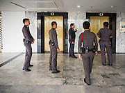 "26 JUNE 2015 - BANGKOK, THAILAND:  Thai police in the lobby of the Foreign Correspondents' Club of Thailand after they cancelled the release of a Human Rights Watch (HRW) report, ""Persecuting 'Evil Way' Religion: Abuses against Montagnards in Vietnam"", at the Foreign Correspondents' Club of Thailand (FCCT) in Bangkok Friday morning. The report made no mention of the human rights situation in Thailand. The Thai Ministry of Foreign Affairs (MFA) contacted HRW Thursday afternoon and asked them to cancel the program because it was a ""sensitive"" matter that could impact on Thai-Vietnam relations. HRW told the MFA that they would go ahead with the report's release. Friday morning, before the report was scheduled to be released, Thai police officers arrived at the FCCT and cancelled the event. Phil Robertson, deputy director of Human Rights Watch's Asia division, said, ""By stepping in to defend a neighboring state's human rights violations against a group of its people and interrupting a scheduled press conference, Thailand's military junta is violating freedom of assembly and demonstrating its contempt for freedom of the press.""      PHOTO BY JACK KURTZ"