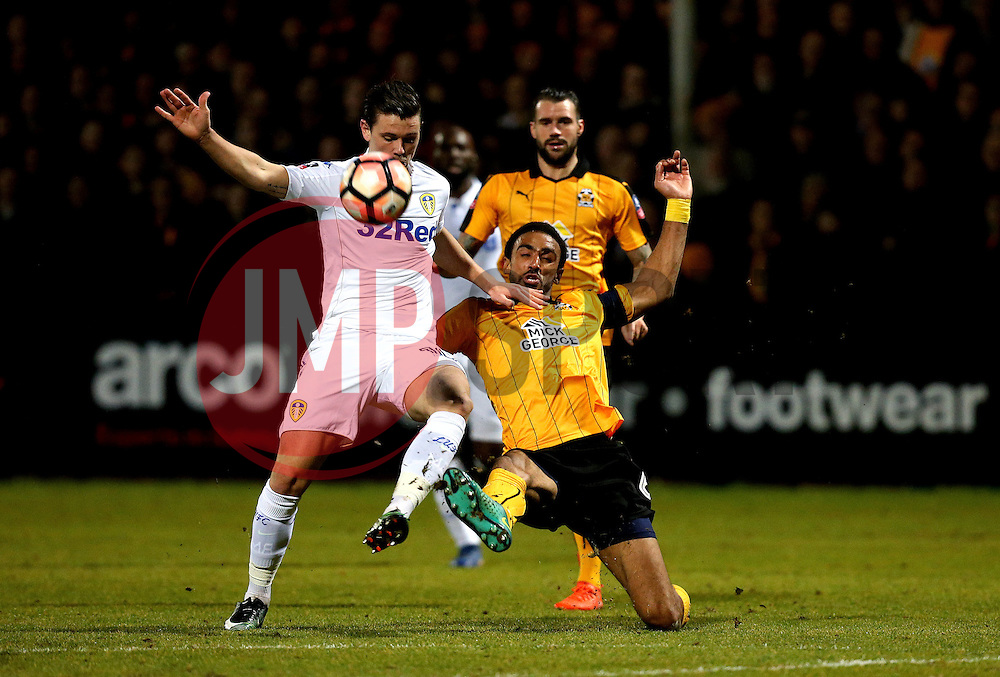 Leon Legge of Cambridge United tackles Marcus Antonsson of Leeds United - Mandatory by-line: Robbie Stephenson/JMP - 09/01/2017 - FOOTBALL - Cambs Glass Stadium - Cambridge, England - Cambridge United v Leeds United - FA Cup third round