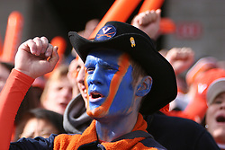 A UVA fan cheers after a touchdown.  The Virginia Cavaliers defeated the Minnesota Golden Gophers 34-31 at the Music City Bowl in Nashville, TN on December 30, 2005.