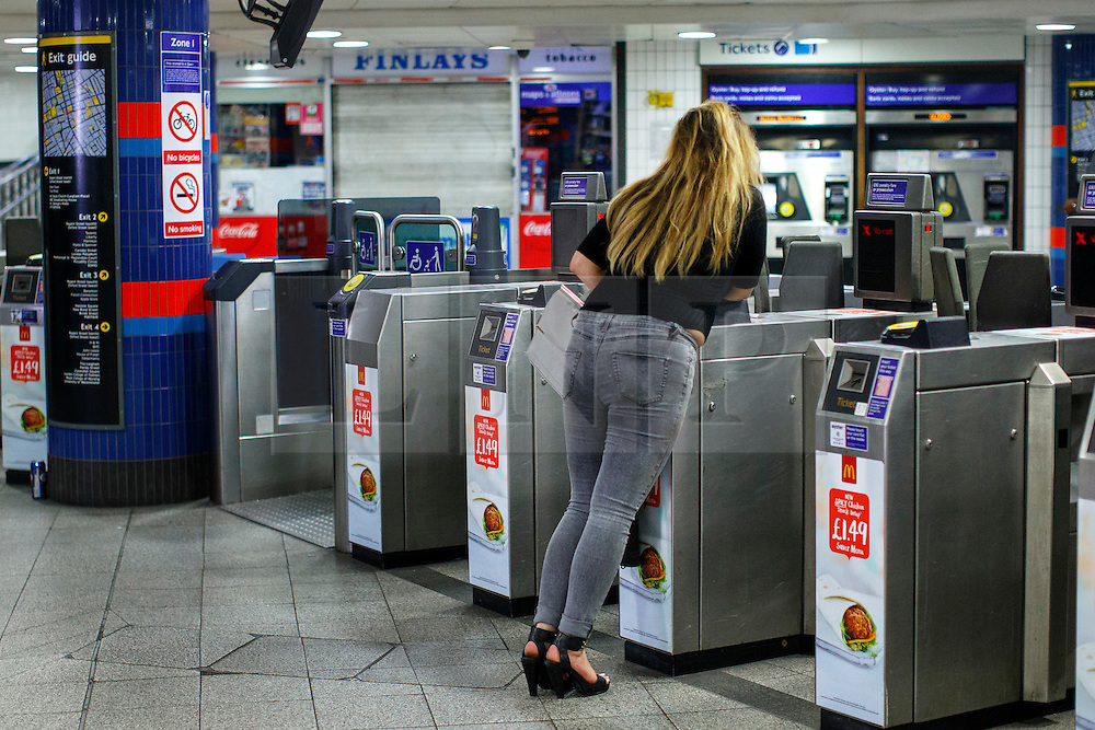 © Licensed to London News Pictures. 20/08/2016. London, UK. Tube passengers buy tickets at Oxford Circus station in London to use the night tube services for the first time on 20 August 2016. Transport for London started a 24-hour Tube service on Victoria and Central lines as demand has soared over recent years, with passenger numbers on Friday and Saturday nights up by around 70 per cent since 2000. The plan was announced in November 2013 and intended to begin in September 2015, but strikes over pay delayed the start by nearly another year. Photo credit: Tolga Akmen/LNP