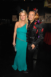 Actress TARA REID and designer JULIEN MACDONALD at Andy & Patti Wong's Chinese new Year party held at County Hall and Dali Universe, London on 26th January 2008.<br />