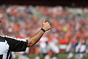 An NFL official in action during the Cleveland Browns 2017 NFL week 4 regular season football game against the Cincinnati Bengals, Sunday, Oct. 1, 2017 in Cleveland. The Bengals won the game 31-7. (©Paul Anthony Spinelli)
