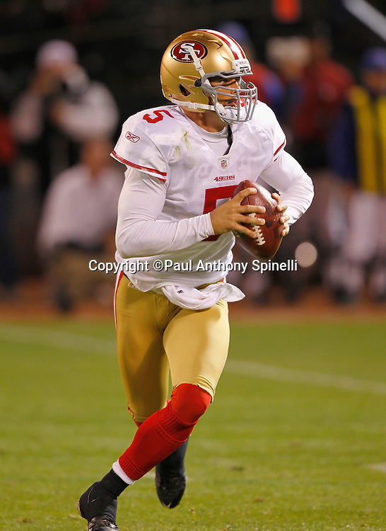 San Francisco 49ers quarterback David Carr (5) rolls out while looking to pass for a two point conversion in the fourth quarter during the NFL preseason week 3 football game against the Oakland Raiders on Saturday, August 28, 2010 in Oakland, California. The 49ers won the game 28-24. (©Paul Anthony Spinelli)