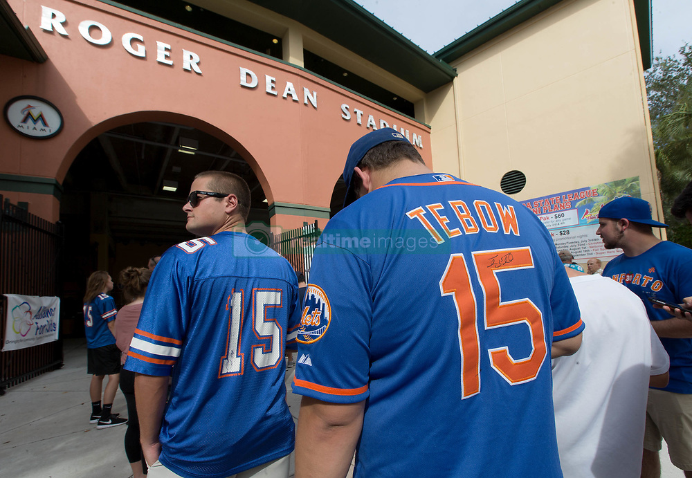July 7, 2017 - Jupiter, Florida, U.S. - Tim Tebow fans line up outside Roger Dean Stadium in Jupiter, Florida on July 7, 2017. (Credit Image: © Allen Eyestone/The Palm Beach Post via ZUMA Wire)