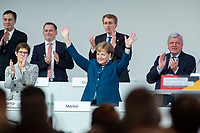 07 DEC 2018, HAMBURG/GERMANY:<br /> Angela Merkel, CDU, Bundeskanzlerin, nach Ihrer letzten Rede als Parteivorsitzende, unten links: Annegret Kramp-Karrenbauer, CDU Generalsekretaerin, unten rechts: Volker Bouvier, CDU, Ministerpraesident Hessen, hinten v.L.n.R.: David McAllister, CDU, MdEP, Dr. Roland Heintze, CDU Landesvorsitzender Hamburg, Daniel Guenther, CDU, Ministerpraesident Schleswig-Holstein, CDU Bundesparteitag, Messe Hamburg<br /> IMAGE: 20181207-01-083<br /> KEYWORDS: party congress, Appluas, applaudiren, klatschen, Jubel, Daniel Günther