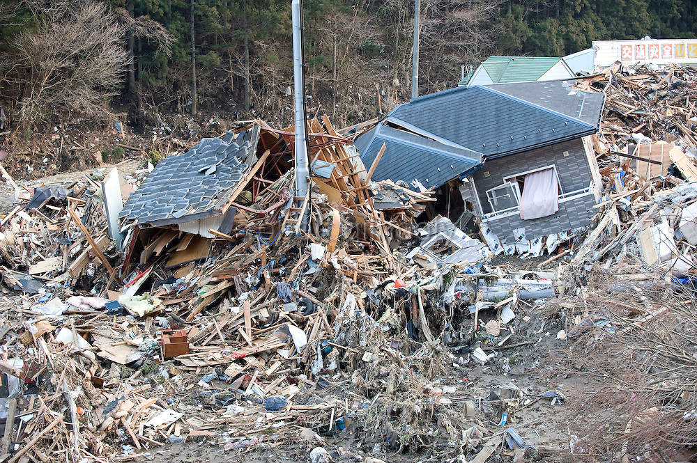 Shattered homes and other debris that was swept inland by the tsunami that followed the March 11 magnitude 8.8 quake are all that remain of the coastal area of Minami Sanriku Town, Miyagi Prefecture, Japan on 13 March, 2011. Some 10,000 people out of the town's population of  17,666 are reported as missing. Photographer: Robert Gilhooly