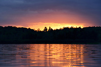 A post-storm glow appears at sunset over Vaughn Lake <br /> Glennie, Michigan