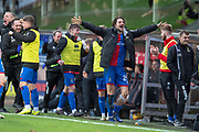Charlie Trafford (#24) of Inverness Caledonian Thistle FC and the Inverness bench celebrate the winning goal during the William Hill Scottish Cup quarter final match between Dundee United and Inverness CT at Tannadice Park, Dundee, Scotland on 3 March 2019.