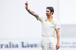 © Licensed to London News Pictures. 27/12/2013. Mitchell Johnson raises the ball to the crowd after getting 5 wickets  during Day 2 of the Ashes Boxing Day Test Match between Australia Vs England at the MCG on 27 December, 2013 in Melbourne, Australia. Photo credit : Asanka Brendon Ratnayake/LNP