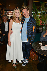 DONNA AIR and HENRY HOLLAND at a party to celebrate the launch of Sackville's Bar & Grill, 8a Sackville Street, London on 15th July 2015.