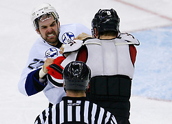 March 7, 2008; Newark, NJ, USA; Tampa Bay Lightning defenseman Dan Boyle (22) and New Jersey Devils left wing Zach Parise (9) fight during the third period at the Prudential Center in Newark, NJ. The Devils defeated the Lightning in overtime 2-1 on a goal by New Jersey Devils left wing Patrik Elias (26).