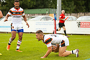 Bradford Bulls centre Vila Halafihi (26) scores a try and celebrates to make the score 6-8 during the Kingstone Press Championship match between Swinton Lions and Bradford Bulls at the Willows, Salford, United Kingdom on 20 August 2017. Photo by Simon Davies.