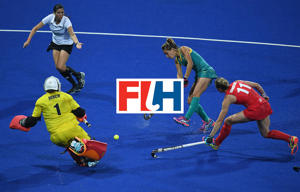 Australia's Brooke Peris (2R) attempts a shot on goal during the women's field hockey Britain vs Australia match of the Rio 2016 Olympics Games at the Olympic Hockey Centre in Rio de Janeiro on August, 6 2016. / AFP / MANAN VATSYAYANA        (Photo credit should read MANAN VATSYAYANA/AFP/Getty Images)