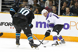 November 15, 2010; San Jose, CA, USA;  Los Angeles Kings center Brad Richardson (15) is defended by San Jose Sharks center Jamal Mayers (10) during the first period at HP Pavilion. Mandatory Credit: Jason O. Watson / US PRESSWIRE