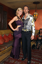 Actress MARGO STILLEY and CHRISTIAN HELLAND at a dinner hosted by Ayesha Makim and leading stylist Mohieb Dahabieh to celebrate the forthcoming London Fashion Week held at the exotic restaurant Levant, 76 Wigmore Street, London W1 on 8th September 2005.<br /><br />NON EXCLUSIVE - WORLD RIGHTS