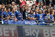 The trophy lift AFC Wimbledon defender Barry Fuller (2) during the Sky Bet League 2 play off final match between AFC Wimbledon and Plymouth Argyle at Wembley Stadium, London, England on 30 May 2016.