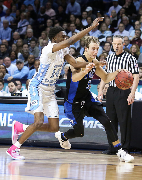 Duke guard Luke Kennard (5) is pressured by North Carolina guard Brandon Robinson (14) during the semifinals of the 2017 New York Life ACC Tournament at the Barclays Center in Brooklyn, N.Y., Friday, March 10, 2017. (Photo by David Welker, theACC.com)