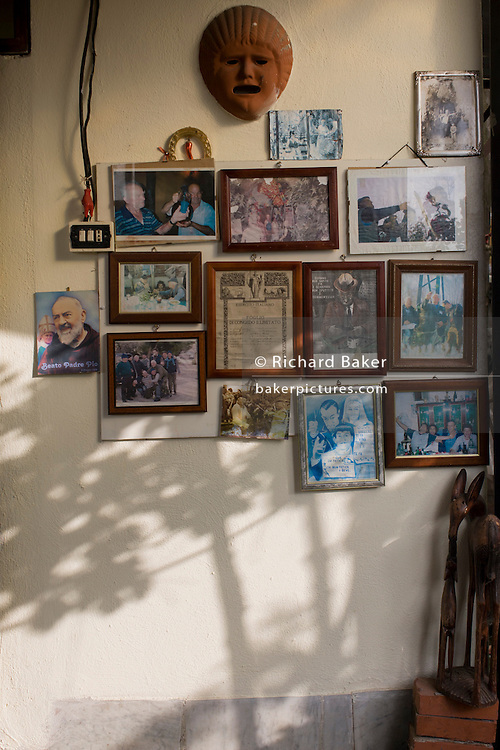 Family memories on a wall of a smallholding located on the slopes of the Vesuvius volcano which last erupted in 1945.