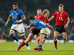 England replacement Billy Twelvetrees is tackled by Samoa Full Back Ken Pisi - Photo mandatory by-line: Rogan Thomson/JMP - 07966 386802 - 22/11/2014 - SPORT - RUGBY UNION - London, England - Twickenham Stadium - England v Samoa - QBE Autumn Internationals.
