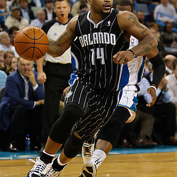 January 12, 2011; New Orleans, LA, USA; Orlando Magic point guard Jameer Nelson (14) drives past New Orleans Hornets point guard Chris Paul (3) during the fourth quarter at the New Orleans Arena. The Hornets defeated the Magic 92-89.  Mandatory Credit: Derick E. Hingle