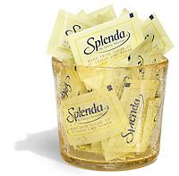 pile of splenda packets in a glass