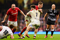 Liam Williams of Wales is tackled by Tom Curry of England - Mandatory by-line: Ryan Hiscott/JMP - 23/02/2019 - RUGBY - Principality Stadium - Cardiff, Wales - Wales v England - Guinness Six Nations